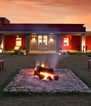 A sunset and fire pit at La Dormida, shooters paradise